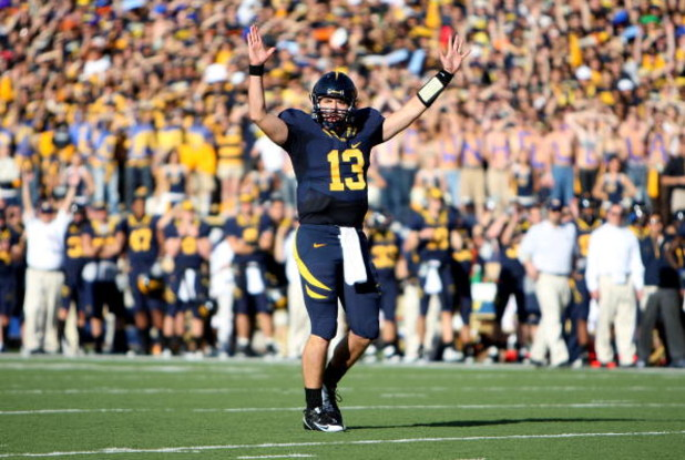 BERKELEY, CA - NOVEMBER 22:  Kevin Riley #13 of the California Golden Bears signals for a touchdown against the Stanford Cardinal during an NCAA football game on November 22, 2008 at Memorial Stadium in Berkeley, California.  (Photo by Jed Jacobsohn/Getty