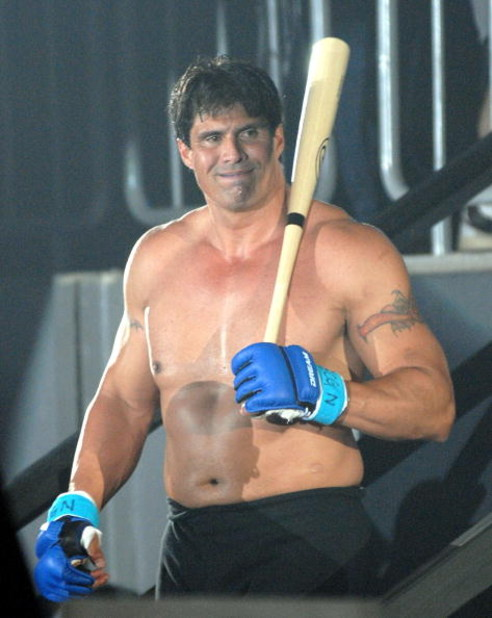 YOKOHAMA, JAPAN - MAY 26:  Former Oakland Athletics slugger Jose Canseco (L) walks to the ring with holding a bat prior to the match with Choi Hong-man at first Round of Super Hulk Tournament during Dream.9 at Yokohama Arena on May 26, 2009 in Yokohama, K