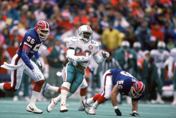 ORCHARD PARK, NY - DECEMBER 23:  Wide receiver Mark Clayton #83 of the Miami Dolphins runs with the ball against the Buffalo Bills during a game at Ralph Wilson Stadium on December 23, 1990 in Orchard Park, New York.  The Bills won 24-17.  (Photo by Rick