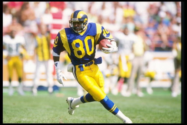 24 Sep 1989: Wide receiver Henry Ellard of the Los Angeles Rams moves the ball during a game against the Green Bay Packers at Anaheim Stadium in Anaheim, California. The Rams won the game, 41-38.