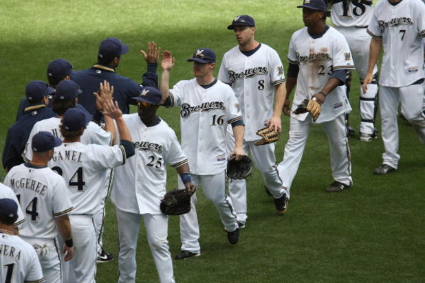 MILWAUKEE - MAY 14: Mike Cameron #25, Chris Duffy #16, Ryan Braun #6 and Rickie Weeks #23 of the Milwaukee Brewers celebrate a win over the Florida Marlins with teammates on May 14, 2009 at Miller Park in Milwaukee, Wisconsin. The Brewers defeated the Mar