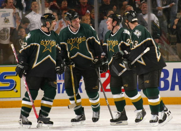 DALLAS - APRIL 12:  (L-R) Shayne Corson #72, Chris Therien #6, Steve Ott #29 and Bill Guerin #13 of the Dallas Stars share some words during a break in game three of the first round of the 2004 Stanley Cup Playoffs against the Colorado Avalanche at the Am