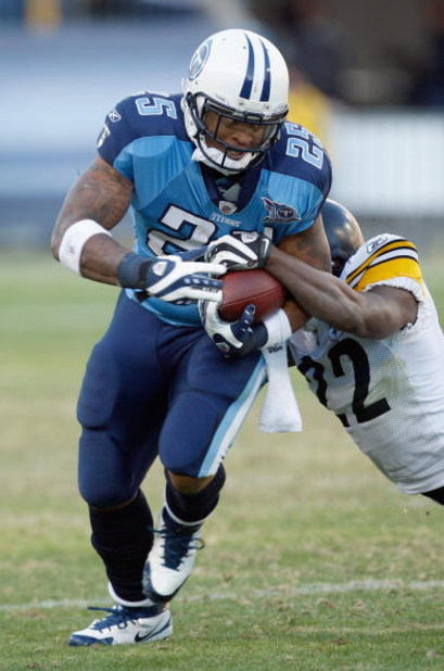 NASHVILLE,TN - DECEMBER 21:  Lendale White #25 of the Tennessee Titans carries the ball as he is grabbed by William Gay #22 of the Pittsburgh Steelers on December 21, 2008 at LP Field in Nashville, Tennessee. (Photo by: Streeter Lecka/Getty Images)
