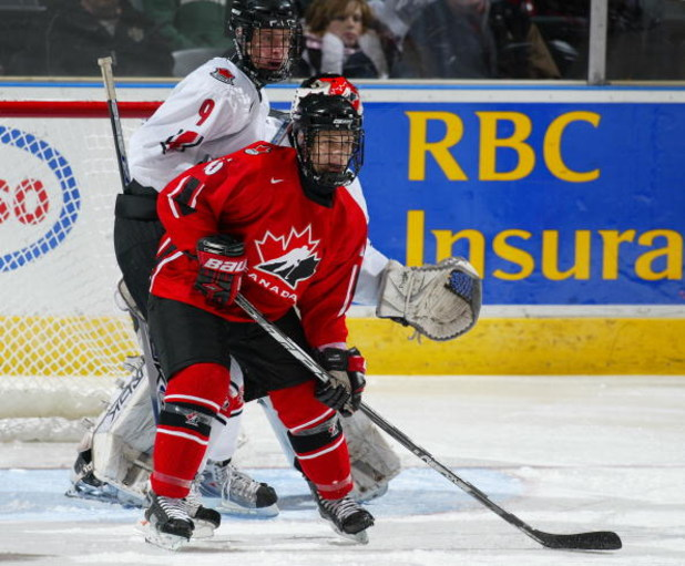 LONDON,ON - JANUARY 3:  Andrew Agozzino #15 of Team Ontario stands in front of Carter Ashton #9 of Team West in a game on January 3, 2008 at the John Labatt Centre in London, Ontario. Team Ontario defeated Team West 4-3 to earn a spot in the gold medal ga