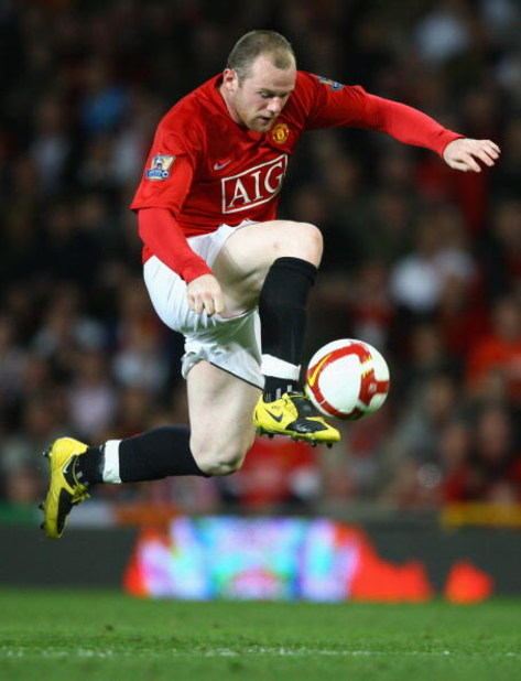 MANCHESTER, UNITED KINGDOM - APRIL 22:   Wayne Rooney of Manchester United in action during the Barclays Premier League match between Manchester United and Portsmouth at Old Trafford on April 22, 2009 in Manchester, England. (Photo by Alex Livesey/Getty I