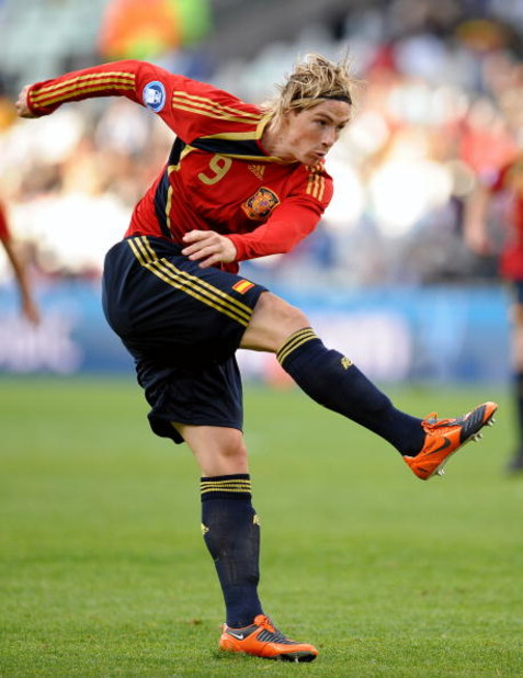 BLOEMFONTEIN, SOUTH AFRICA - JUNE 17:  Fernando Torres of Spain in action during the FIFA Confederations Cup match between Spain and Iraq at Free State Stadium on June 17, 2009 in Bloemfontein, South Africa. Spain won the match 1-0. (Photo by Jasper Juine