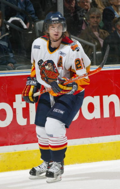 LONDON, CANADA - OCTOBER 30:  Rob Hisey #26 of the Erie Otters eyes the play from the end boards during the Ontario Hockey League game against the London Knights at John Labatt Centre on October 30, 2004 in London, Ontario, Canada.  The Knights defeated t