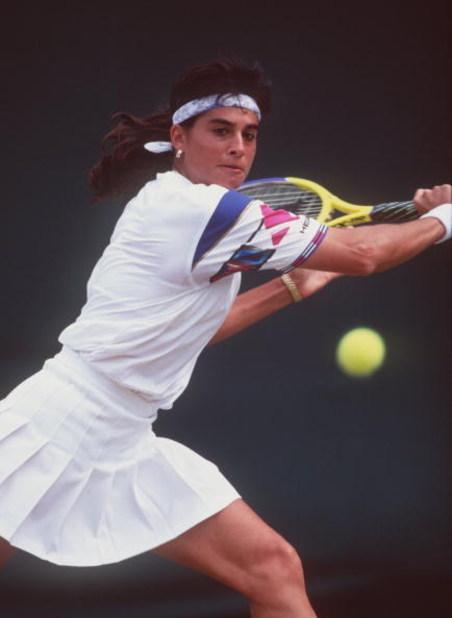 3 JUL 1995:  GABRIELA SABATINI OF ARGENTINA HITS A BACKHAND RETURN AGAINST LISA RAYMOND OF THE USA AT WIMBLEDON. SABATINI WON THE MATCH IN THREE SETS 6-0, 3-6, 7-5. Mandatory Credit: Clive Brunskill/ALLSPORT
