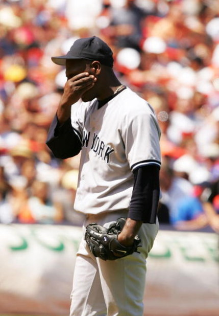 NEW YORK - JULY 3:  Starting pitcher Jose Contreras #52 of the New York Yankees covers his face after giving up a home run to Ty Wigginton of the New York Mets on July 3, 2004 at Shea Stadium in the Queens borough of New York City. The Mets beat the Yanke