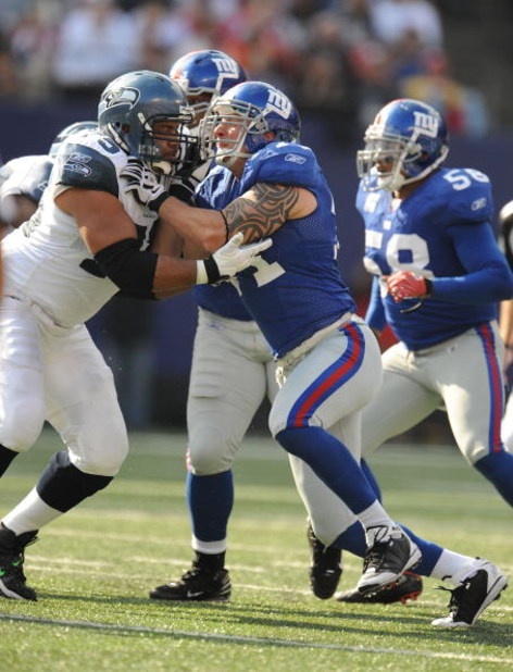 EAST RUTHERFORD, NJ - OCTOBER 05:  Dave Tollefson #71 of the New York Giants battles Sean Locklear #75 of the Seattle Seahawks during their game on October 5, 2008 at Giants Stadium in East Rutherford, New Jersey.  (Photo by Al Bello/Getty Images)
