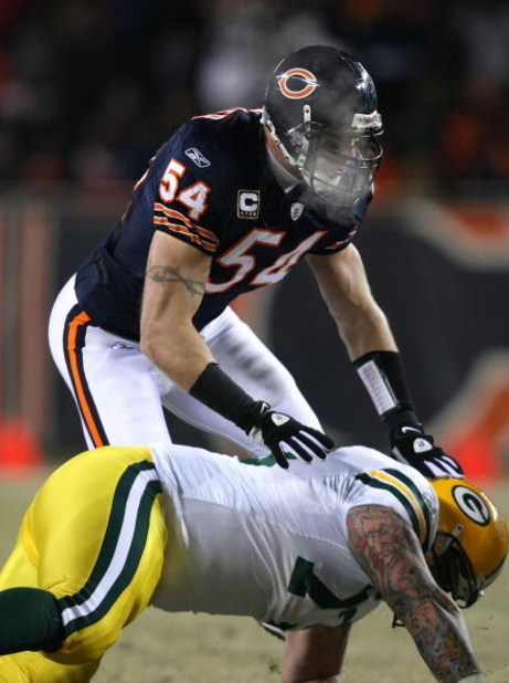 CHICAGO - DECEMBER 22: Brian Urlacher #54 of the Chicago Bears sheds a block by Daryn Colledge #73 of the Green Bay Packers on December 22, 2008 at Soldier Field in Chicago, Illinois. The Bears defeated the Packers 20-17 in overtime. (Photo by Jonathan Da