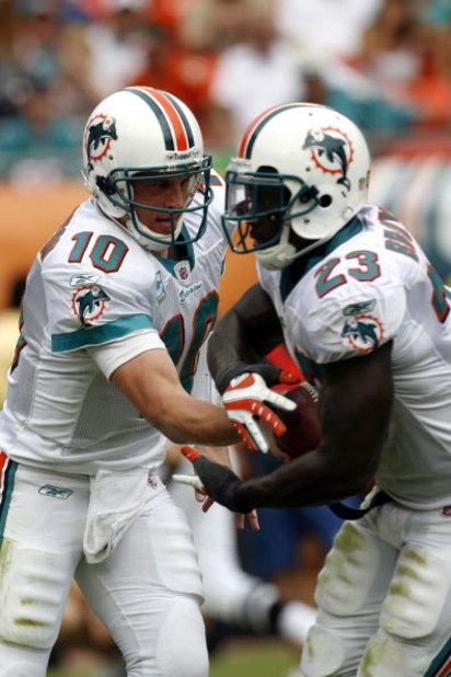 MIAMI - OCTOBER 19: Quarterback Chad Pennington #10 of the Miami Dolphins hands off to teammate Running back Ronnie Brown #23 against the Baltimore Ravens in the first quarter at Dolphin Stadium on October 19, 2008 in Miami, Florida. (Photo by Eliot J. Sc
