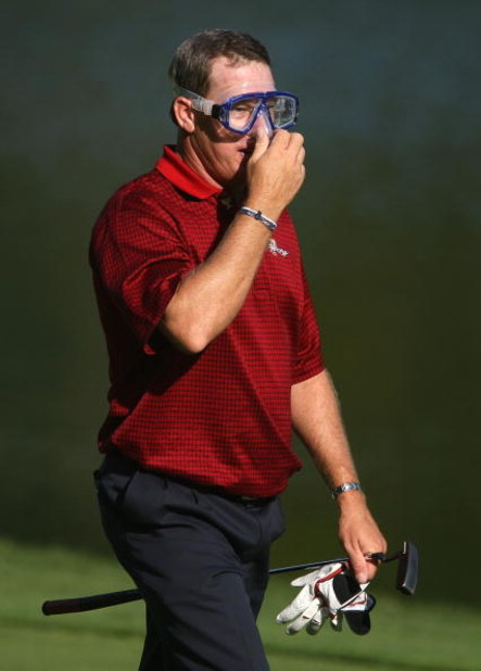 MONTREAL - SEPTEMBER 30:  Woody Austin of the U.S. Team walks to the 14th green wearing a dive mask during the final day singles matches at The Presidents Cup at The Royal Montreal Golf Club on September 30, 2007 in Montreal, Quebec, Canada.  (Photo by Sc