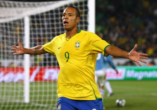 PRETORIA, SOUTH AFRICA - JUNE 21:  Luis Fabiano of Brazil celebrates after scoring his second goal during the FIFA Confederations Cup match between Italy and Brazil at the Loftus Versfeld Stadium on June 21, 2009 in Pretoria, South Africa.  (Photo by Alex
