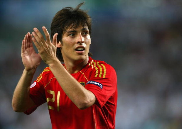 VIENNA, AUSTRIA - JUNE 22:  David Silva of Spain acknowledges the fans after victory in the UEFA EURO 2008 Quarter Final match between Spain and Italy at Ernst Happel Stadion on June 22, 2008 in Vienna, Austria.  (Photo by Clive Rose/Getty Images)
