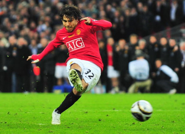 LONDON - MARCH 01:  Carlos Tevez of Manchester United scores a penalty in the shoot out during the Carling Cup Final match between Manchester United and Tottenham Hotspur at Wembley Stadium on March 1, 2009 in London, England.  (Photo by Mike Hewitt/Getty