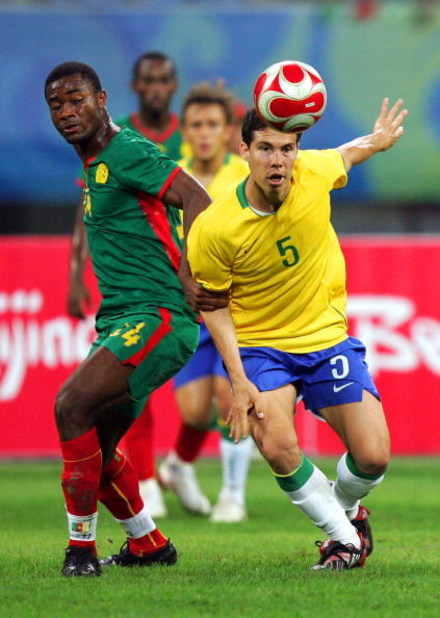 SHENYANG, CHINA - AUGUST 16:  Hernanes of Brazil and Aurelien Chedjou of Cameroon compete for the ball during the Men's Quarter Final match between Brazil and Cameroon at Shenyang Olympic Stadium on Day 8 of the Beijing 2008 Olympic Games on August 16, 20