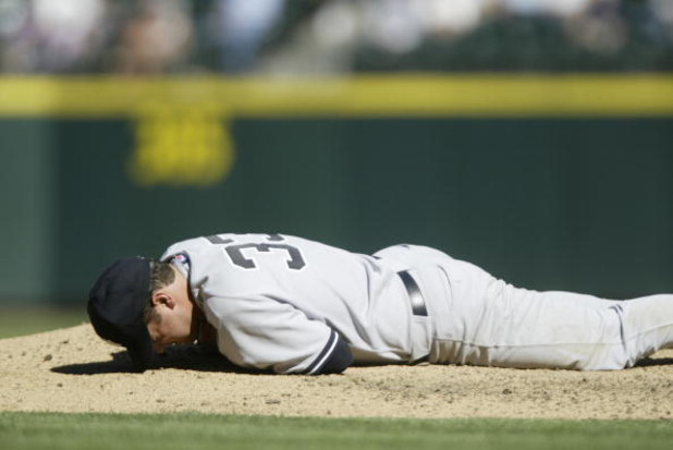 SEATTLE - SEPTEMBER 1:  Starting pitcher Jaret Wright #33 of the New York Yankees lies on the ground after being hit by a ball off the bat of Raul Ibanez #28 of the Seattle Mariners in the sixth inning on September 1, 2005 at Safeco Field in Seattle, Wash