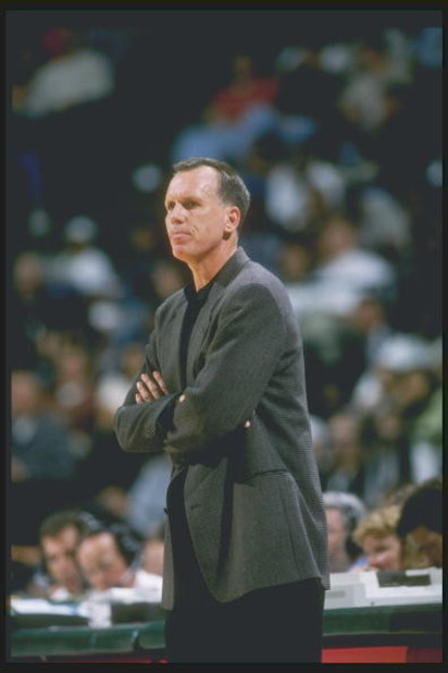 Coach Doug Collins of the Detroit Pistons watches his players during a game against the Dallas Mavericks at Reunion Arena in Dallas, Texas. The Pistons won the game 100-82.