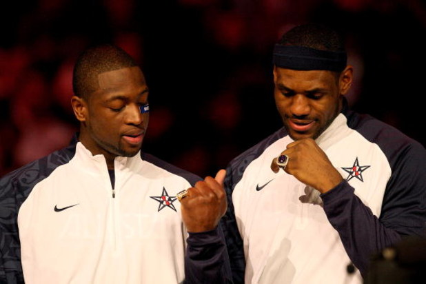 PHOENIX - FEBRUARY 15:  (L-R) Dwyane Wade and LeBron James, members of the gold medal winning USA Olympic basketball team, admire their rings during half time of the 58th NBA All-Star Game, part of 2009 NBA All-Star Weekend at US Airways Center on Februar