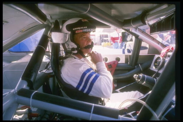 Dick Trickle sits in his car before the start of a NASCAR race.