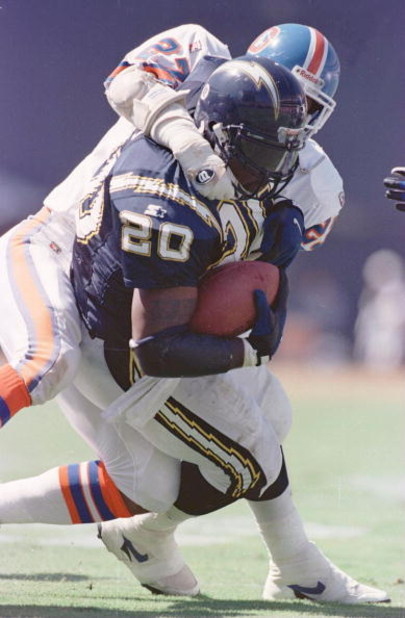 24 Sep 1995: DENVER SAFETY STEVE ATWATER, #27, TACKLES SAN DIEGO RUNNING BACK NATRONE MEANS DURING THE SECOND QUARTER OF THE CHARGERS GAME VERSUS BRONCOS AT JACK MURPHY STADIUM IN SAN DIEGO, CALIFORNIA.