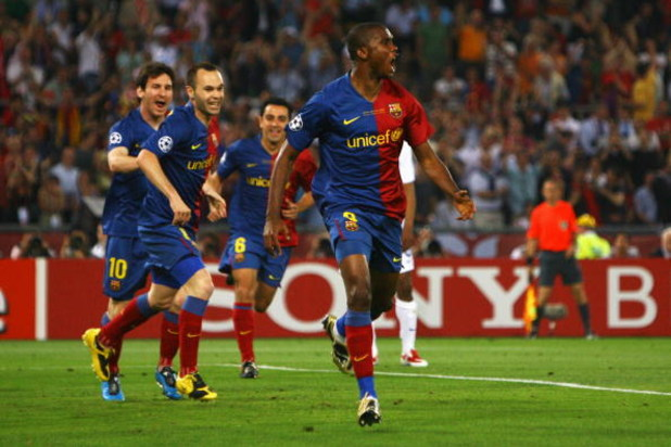 ROME - MAY 27:  Samuel Eto'o of Barcelona celebrates after he scored the first goal for Barcelona during the UEFA Champions League Final match between Manchester United and Barcelona at the Stadio Olimpico on May 27, 2009 in Rome, Italy.  (Photo by Alex L