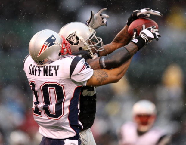 OAKLAND, CA - DECEMBER 14: Jabar Gaffney #10 of the New England Patriots can't catch a pass as Chris Johnson #37 of the Oakland Raiders defends during an NFL game on December 14, 2008 at the Oakland-Alameda County Coliseum in Oakland, California.  (Photo