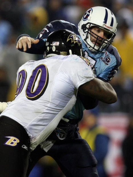NASHVILLE, TN - JANUARY 10:  Quarterback Kerry Collins #5 of the Tennessee Titans is hit as he throws the ball by tackle Trevor Pryce #90 of the Baltimore Ravens during the AFC Divisional Playoff Game on January 10, 2009 at LP Field in Nashville, Tennesse