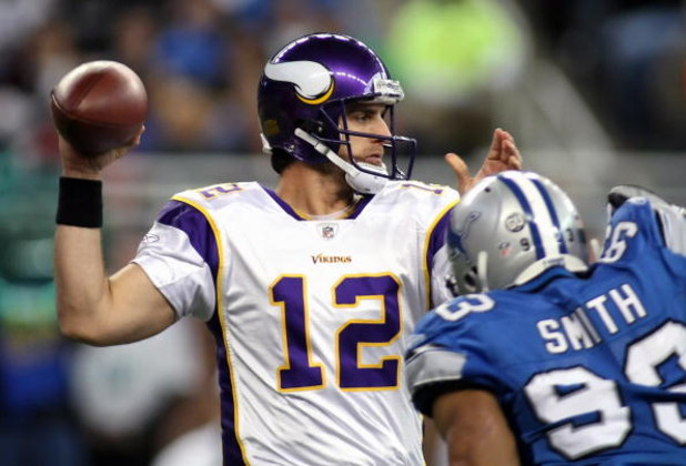 DETROIT - DECEMBER 07:  Quarterback Gus Frerotte #12 of the Minnesota Vikings drops back to pass under pressure from Corey Smith #93 of the Detroit Lions during the NFL game at Ford Field on December 7, 2008 in Detroit, Michigan.  (Photo by Christian Pete
