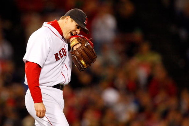 BOSTON - OCTOBER 16:  Relief pitcher Jonathan Papelbon #58 of the Boston Red Sox looks on against the Tampa Bay Rays in game five of the American League Championship Series during the 2008 MLB playoffs at Fenway Park on October 16, 2008 in Boston, Massach