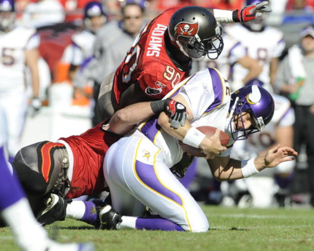 TAMPA, FL - NOVEMBER 16: Defensive end Gaines Adams #90 of the Tampa Bay Buccaneers sacks quarterback Gus Frerotte #12 of the Minnesota Vikings at Raymond James Stadium on November 16, 2008 in Tampa, Florida.  (Photo by Al Messerschmidt/Getty Images)