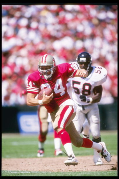 10 Sep 1995:  Tight end Brent Jones of the San Francisco 49ers moves the ball during a game against the Atlanta Falcons during a game at 3Com Park in San Francisco, California.  The 49ers won the game, 41-10. Mandatory Credit: Mike Powell  /Allsport