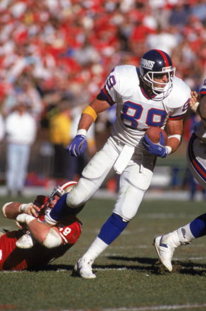 SAN FRANCISCO - JANUARY 20:  Tight end Mark Bavaro #89 of the New York Giants tries to get away from the grasps of linebacker Keith DeLong #59 of the San Francisco 49ers in the 1990 NFC Championship game at Candlestick Park on January 20, 1991 in San Fran