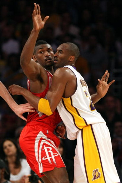 LOS ANGELES, CA - MAY 17:  Kobe Bryant #24 of the Los Angeles Lakers is covered by Ron Artest #96 of the Houston Rockets in the third quarter of Game Seven of the Western Conference Semifinals during the 2009 NBA Playoffs at Staples Center on May 17, 2009