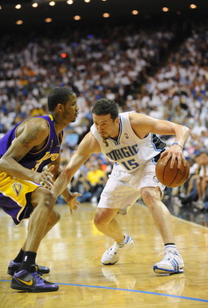 ORLANDO, FL - JUNE 14:  Hedo Turkoglu #15 of the Orlando Magic moves the ball against Trevor Ariza #3 of the Los Angeles Lakers in Game Five of the 2009 NBA Finals on June 14, 2009 at Amway Arena in Orlando, Florida. The Lakers won 99-86.  NOTE TO USER:
