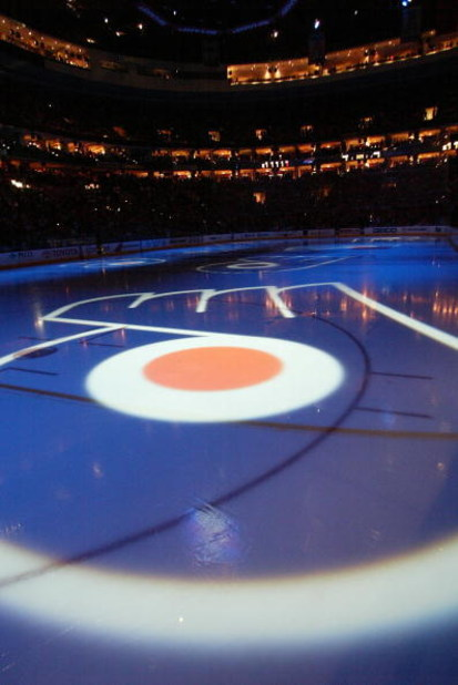 PHILADELPHIA - APRIL 28:  The logo of the Philadelphia Flyers shines on the ice before game four of the Eastern Conference Quarterfinals between the Flyers and the Buffalo Sabres during the 2006 NHL playoffs on April 28, 2006 at the Wachovia Center in Phi