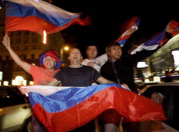 MOSCOW, RUSSIA - MAY 19:  Russian ice hockey fans celebrate victory in the streets after team Russia won the gold medal game against Canada at the 2008 IIHF World Hockey Championships in Canada, on May 19, 2008 in central Moscow, Russia.  (Photo by Epsilo