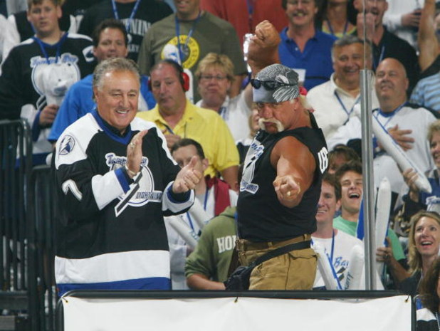 TAMPA, FL - MAY 25:  Hockey Hall of Famer Phil Esposito (L) applauds as professional wrestler Hulk Hogan gestures to his daugther Brooke Hogan who sang the National Anthem before the start of game one of the NHL Stanley Cup Finals between Calgary Flames a