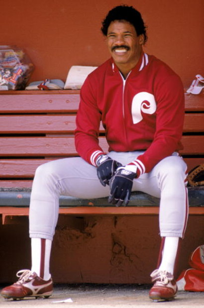 1989 - Juan Samuel of the Philadelphia Phillies looks on from the bench during a game in the 1989 season.  (Photo by:  Otto Greule Jr/Getty Images)