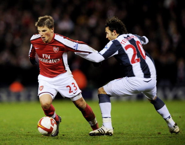 WEST BROMWICH, UNITED KINGDOM - MARCH 03:  Andrey Arshavin (L) of Arsenal holds off a challenge from Filipe Teixeira of West Bromwich Albion during the Barclays Premier League match between West Bromich Albion and Arsenal at The Hawthorns on March 3, 2009