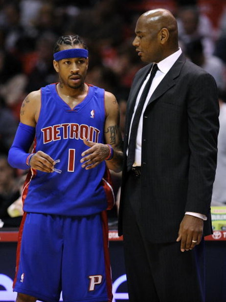 EAST RUTHERFORD, NJ - NOVEMBER 07:  Allen Iverson #1 talks with head coach Michael Curry of the Detroit Pistons during a game against the New Jersey Nets November 7, 2008 at the Izod Arena in East Rutherford, New Jersey.  (Photo by Jeff Zelevansky/Getty I