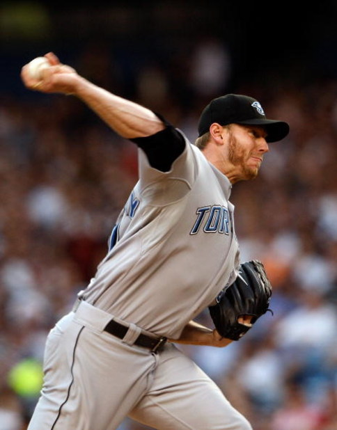 NEW YORK - JUNE 03:  Roy Halladay #32 of the Toronto Blue Jays pitches against the New York Yankees on June 3, 2008 at Yankee Stadium in the Bronx borough of New York City.  (Photo by Nick Laham/Getty Images)