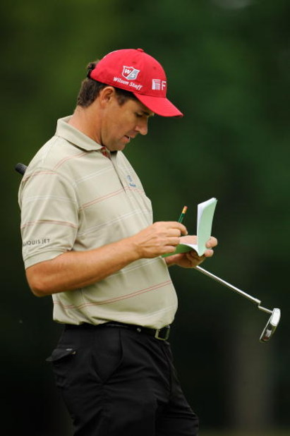 FARMINGDALE, NY - JUNE 16:  Padraig Harrington of Ireland writes in his yardage book during the second day of previews to the 109th U.S. Open on the Black Course at Bethpage State Park on June 16, 2009 in Farmingdale, New York.  (Photo by Sam Greenwood/Ge