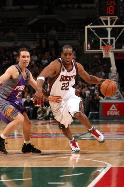 MILWAUKEE - JANUARY 22:  Michael Redd #22 of the Milwaukee Bucks drives against Steve Nash #13 of the Phoenix Suns at the Bradley Center on January 22, 2008 in Milwaukee, Wisconsin. The Suns won 114-105. NOTE TO USER: User expressly acknowledges and agree