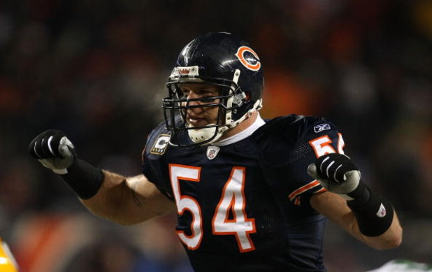 CHICAGO - DECEMBER 22: Brian Urlacher #54 of the Chicago Bears calls defensive signals against the Green Bay Packers on December 22, 2008 at Soldier Field in Chicago, Illinois. The Bears defeated the Packers 20-17 in overtime. (Photo by Jonathan Daniel/Ge