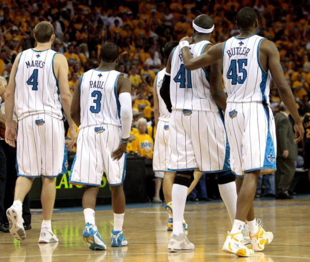 NEW ORLEANS - APRIL 25:  (L-R) Sean Marks #4, Chris Paul #4,James Posey #41 and Rasual Butler #45 of the New Orleans Hornets walk across the court during Game Three of the Western Conference Quarterfinals against the Denver Nuggets during the 2009 NBA Pla