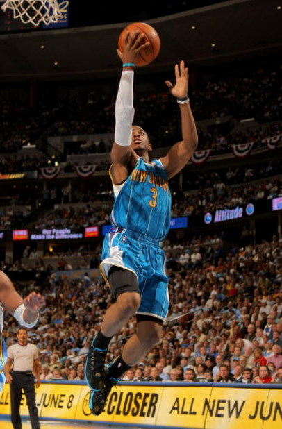 DENVER - APRIL 29:  Chris Paul #3 of the New Orleans Hornets takes a shot against the Denver Nuggets in Game Five of the Western Conference Quarterfinals during the 2009 NBA Playoffs at Pepsi Center on April 29, 2009 in Denver, Colorado. The Nuggets defea