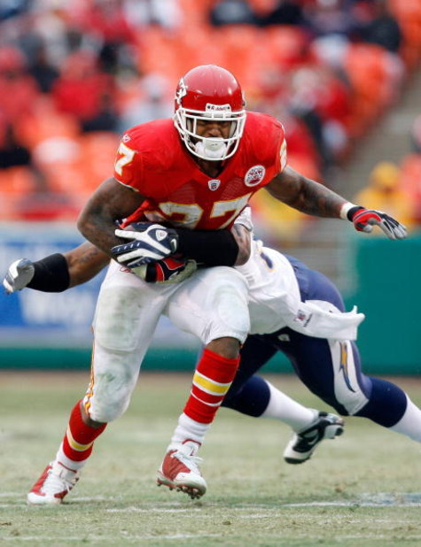 KANSAS CITY, MO - DECEMBER 14:  Larry Johnson #27 of the Kansas City Chiefs tries to break a tackle against the San Diego Chargers during the first half on December 14, 2008 at Arrowhead Stadium in Kansas City, Missouri. The Chiefs lost 22-21.  (Photo by