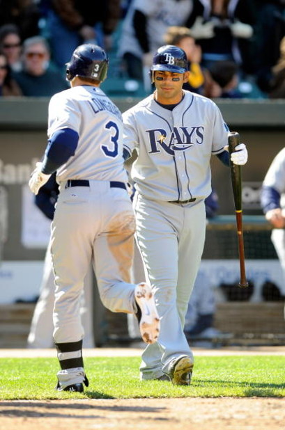 BALTIMORE - APRIL 12:  Evan Longoria #3 of the Tampa Bay Rays in congratulated by Carlos Pena #23 after hitting a home run in the eighth inning against the Baltimore Orioles on April 12, 2009 in Baltimore, Maryland.  (Photo by Greg Fiume/Getty Images)